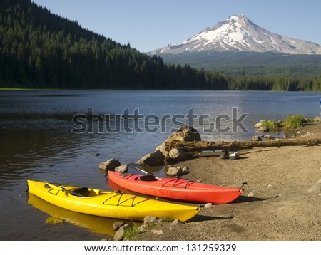 A Beautiful Recreation Area with a Couple Colorful Kayaks on Shore Trillium Lake Mount Hood Oregon - stock photo