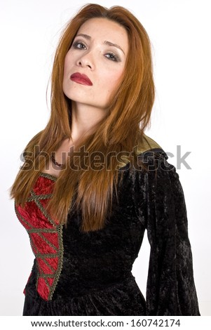 A beautiful, red head, Hispanic woman in a red and black dress in front of a white background.