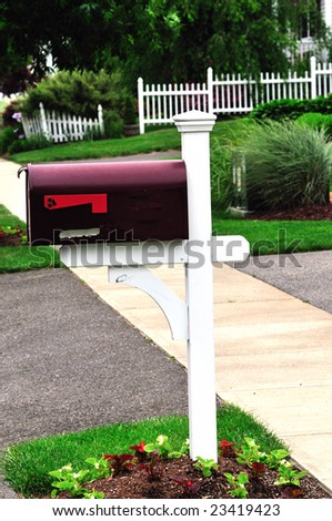 a beautiful red metal mail box at an american home - stock photo