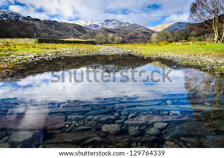 A Beautiful Reflection in a Flooded Pathway at the Lake District - Grasmere, Easedale Tarn - stock photo
