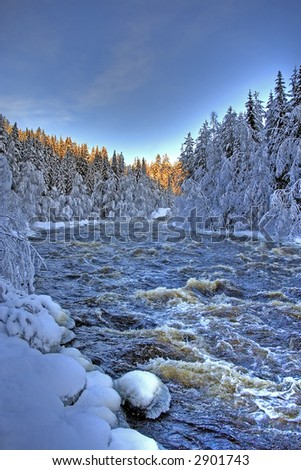 A beautiful river found in the northern part of Sweden - stock photo