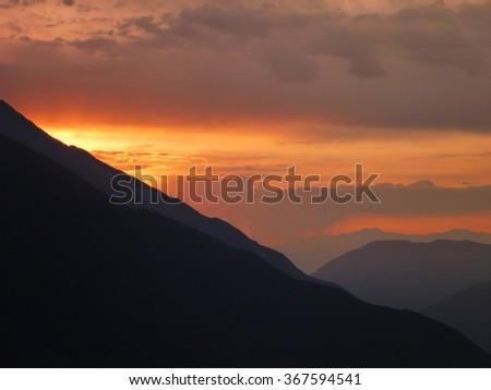 a beautiful romantic sunset at peruvian andes - stock photo