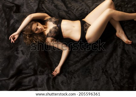 A beautiful Russian woman poses in Stunning lingerie. - stock photo