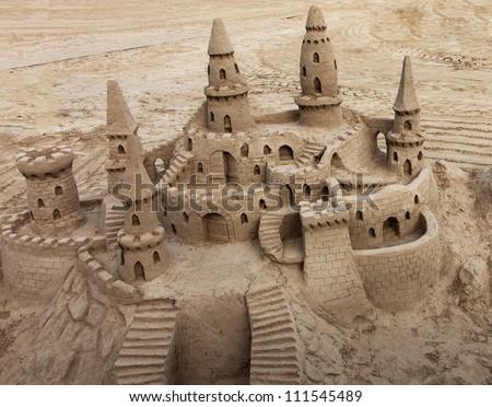A beautiful sand castle on a beach. - stock photo