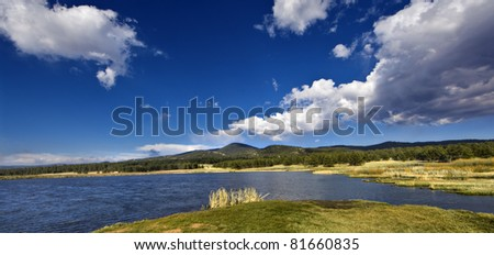 A beautiful scene of a lake in front of some mountains.