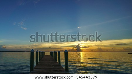 A beautiful scene of docks at sunrise in the Caribbean