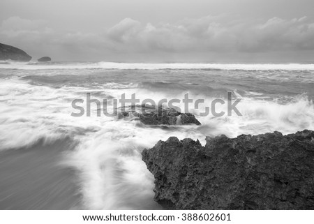 A beautiful scenery of wave splashing at the sunrise. A little noise grainy texture.Nature Composition. Fine Art (black and white)