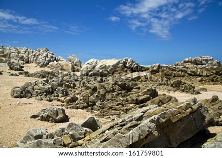 A beautiful scenic beach with lots of rocks and boulders