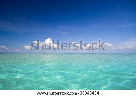 A Beautiful Seascape with Blue Sky and Turquoise Water - stock photo