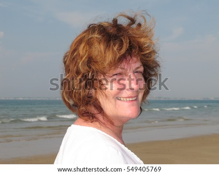 A beautiful senior woman on the beach