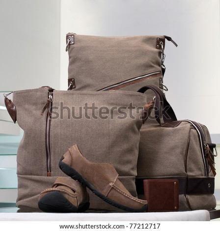 A beautiful set of canvas bags and leather man shoes - stock photo