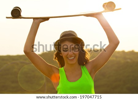 A beautiful skater woman during the sunset, outdoor  - stock photo