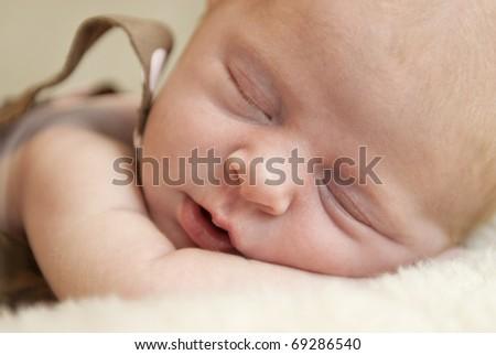 A beautiful sleeping baby girl closeup with selective focus - stock photo