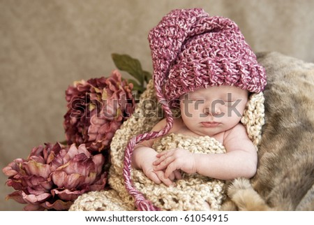 A beautiful sleeping baby girl wearing a hat with a vintage look, soft focus - stock photo