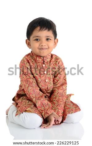 A beautiful smiling indian boy - stock photo