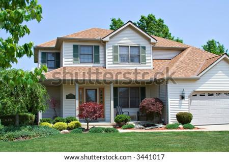 A beautiful suburban American home. - stock photo