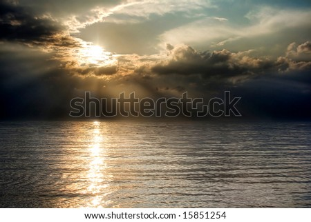 A beautiful summer sunset over the ocean - stock photo