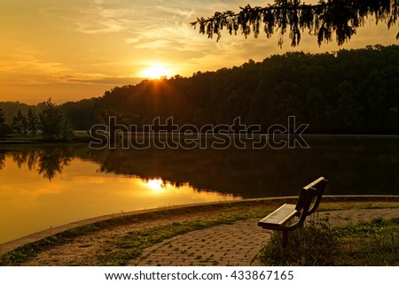 A beautiful sunrise at at Gifford Pinchot State Park in York County, Pennsylvania, USA. - stock photo