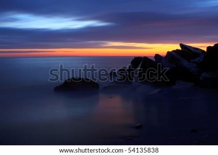 A beautiful sunrise at the beach. - stock photo