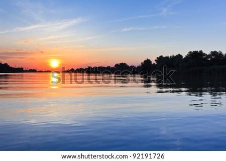 a beautiful sunrise in the Danube Delta, Romania - stock photo