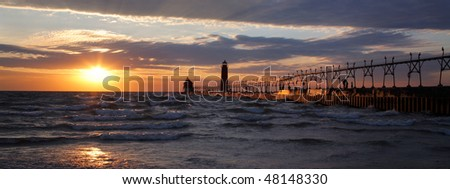 A Beautiful Sunset At The Grand Haven South Pierhead Lighthouse, Michigan - stock photo