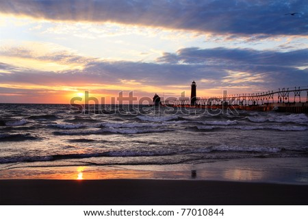 A Beautiful Sunset At The Grand Haven South Pierhead Lighthouse, Michigan, USA - stock photo