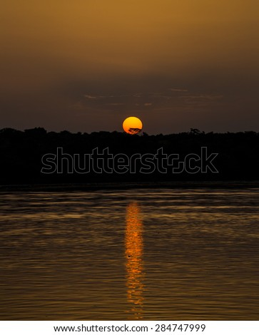 A beautiful sunset at the river Nile at Murchison Falls National Park in Uganda, Africa - stock photo