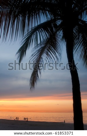 A beautiful sunset in the Isla Verde section of San Juan Puerto Rico. - stock photo