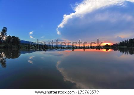 a beautiful sunset on the lake - stock photo