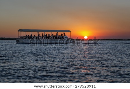 A beautiful sunset on the river Chobe (Chobe National Park) - Botswana, Africa  - stock photo