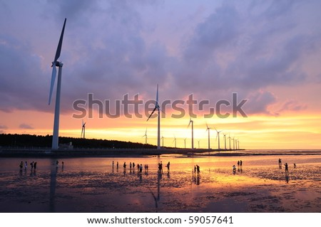 a beautiful sunset on the wind-power station - stock photo