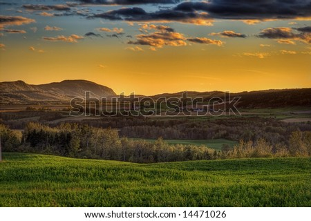 A beautiful sunset over a rural landscape. - stock photo