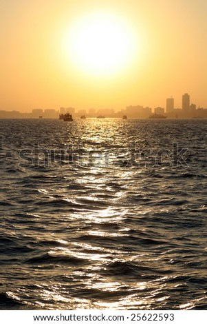 A beautiful sunset over the ocean near Mumbai - stock photo