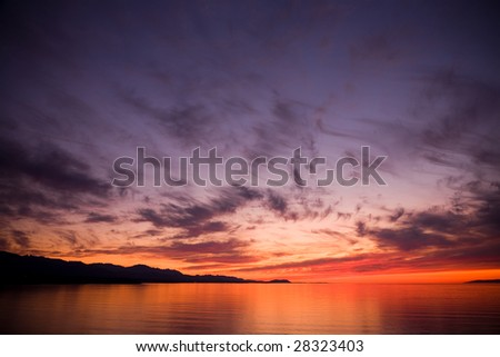 A beautiful sunset over the Strait of Juan de Fuca in Sequim, Washington. - stock photo
