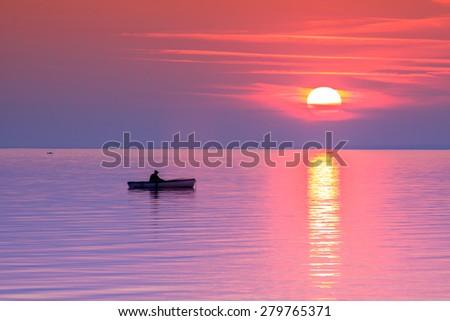 A beautiful Sunset seen the fishing boat in Balaton lake-Hungary.Minimal  color style - stock photo