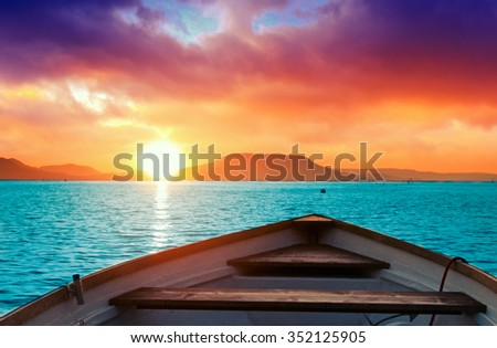 A beautiful sunset seen the fishing boat in lake Balaton-Hungary - stock photo