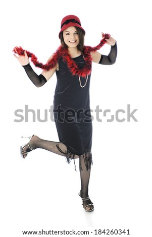 """A beautiful teen """"flapper"""" dancing in her red and black 20's style outfit.  On a white background. - stock photo"""