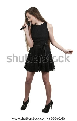 A beautiful teenage woman singer performing at a concert - stock photo