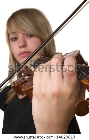 A beautiful teenager playing her violin - stock photo