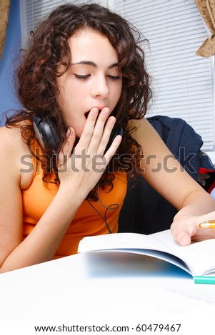 A Beautiful teenager studying at her desk - stock photo