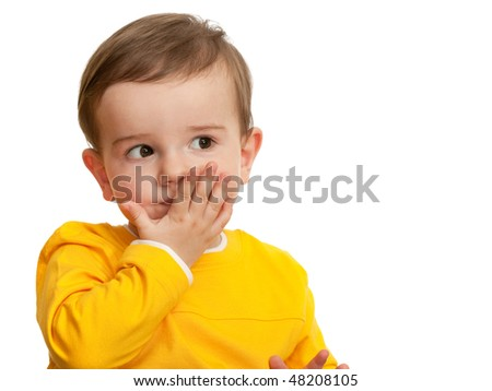 A beautiful toddler is sending a kiss; isolated on the white background