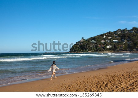 A beautiful tropical beach in sunset - stock photo
