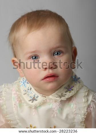 A beautiful upset baby - stock photo