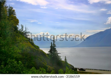 A beautiful view of forests and mountains surrounding Turnagain Arm around the Kenai Peninsula of Alaska. - stock photo