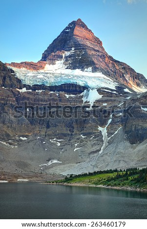 A beautiful view of the north face of Mount Assiniboine in British Columbia Canada. - stock photo