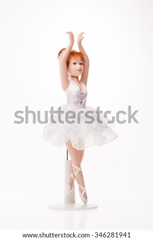 a beautiful vintage doll isolated over a white background