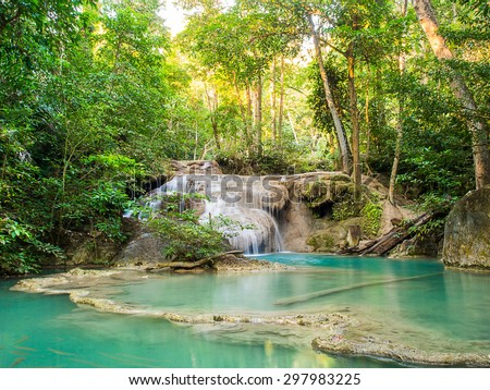 A Beautiful waterfall in deep forest of Erawan National Park in Kanchanaburi Province , Thailand - stock photo