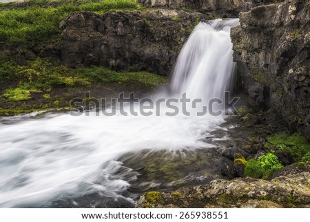 A beautiful waterfall in the Westfjords of Iceland - stock photo