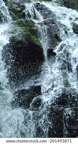 A beautiful waterfall shot with a fast exposure - stock photo