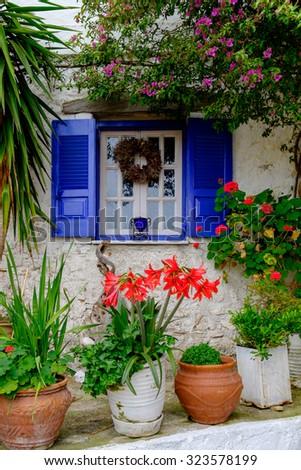 A beautiful window in Afionas village, Corfu, Greece. - stock photo